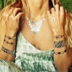 Wear these metallic tattoos alone or with your other jewelry for a cool layering effect, use them to add some bling on your trip to the beach, or try out some ink without the lifelong commitment.