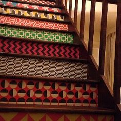 yet another amazing #wallpaper #diy project. Mix and match prints for the backs of your stairs