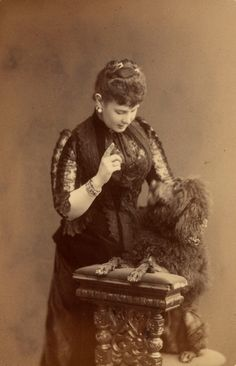 Grand Duchess Maria Pavlovna the Elder (1854 – 1920), née Duchess of Mecklenburg-Shwerin, wife of GD Vladimir Alexandrovich, third son of Emperor Alexander II, and her Poodle. #Romanov