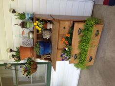 Repurposed desk as front porch flower box, brilliant!