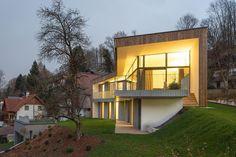 3-storey-home-steep-slope-grass-roofed-garage-1-exterior.jpg