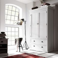 Features: -Made of manufactured wood. -White finish. -2 drawers. -Clothing rod included. -Strong and durable construction. Product Type: -Wardrobe armoire. Finish: -White. Distressed: -Yes. M