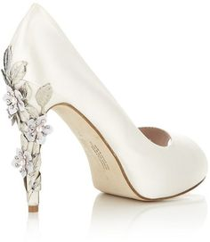 Inspired by a floral theme Harriet Wilde's ivory satin Sakura peep toe pump features an elegant heel with ornate silver leaves and delicate pink cherry blossom cascading down the heel; a unique design that will make your wedding day extra special. $710