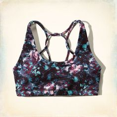Lightweight and comfortable, built-in bra pockets for optional removable cups, strappy back detailing and metallic seagull detail, Imported<bR><br>88% polyester / 12% spandex