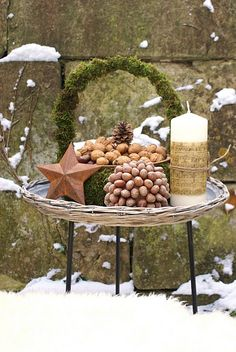 basket, clay dish, candle, bowl filled with nuts, rustic star - instant porch decor for the winter.