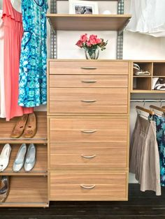 """To get a high-end customized look on a low-end budget, use systems like Cincinnati-based Organized Living's """"Freedom Railway."""" These easy-to-install systems, available from organization-focused retailers, are perfect for the not-so-handy man. Shown here in cypress, the rail system includes adjustable drawers and shelving."""
