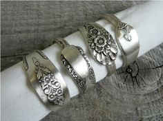 These antique spoons have been fashioned into silver plated napkin rings. As a nostalgic gift, they are sure to be a great conversation piece at any