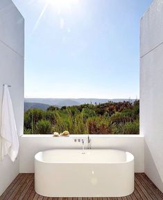 A window? In the bathtub? No problem. These luxury bathtubs have some of the best views the world has to offer. From mountain ranges to beautiful beaches, soak in these fabulous views right from a bathtub. For more design ideas, go to Domino.