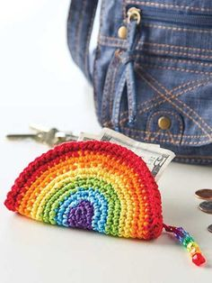 Rainbow Coin Purse Crochet Pattern Download from e-PatternsCentral.com -- Stitch a simple circle in rainbow colors, fold it in half, and then crochet a zipper into the outside edges to create a cute coin purse.