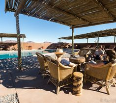 Poolside at Kulala Desert Lodge. Namib Desert, Wish You Are Here, Wilderness, Safari, Pergola, Africa, Outdoor Structures, Patio, Natural