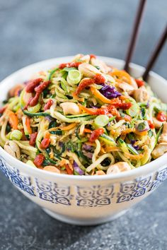 Rainbow Veggie Dragon Noodles colorful recipe with zucchini noodles carrots red bell pepper purple cabbage eggs green onions cashews cilantro - gluten free main dish ideas vegetarian could make vegan