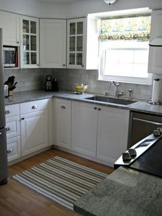 This exactly what i want for my kitchen....countertops, color cabinets, backsplash and flooring!!! Love it!!! Love the window cabinets