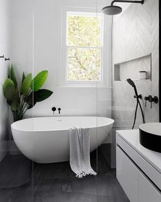 Home Interior Decoration Modern Scandinavian bathroom interior in black and white.Home Interior Decoration Modern Scandinavian bathroom interior in black and white Wet Rooms, Modern Farmhouse Bathroom, Farmhouse Design, Farmhouse Decor, Farmhouse Style, Modern White Bathroom, Modern Bathtub, Farmhouse Remodel, Farmhouse Windows