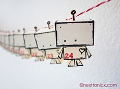 A free template and tutorial to make these cute little paper toy robots into an advent calendar. I don't need an advent calendar, but cute paper toy robots make me happy. Advent Calenders, Diy Advent Calendar, Countdown Calendar, Calendar Ideas, Calendar Printable, Calendar App, Google Calendar, Christmas Calendar, Noel Christmas