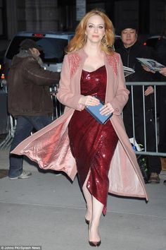 Blown away: The star's light pink coat lifted up with the breeze as she continued forward...