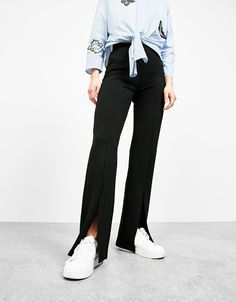 Flared leggings with slits. Discover this and many more items in Bershka with new products every week