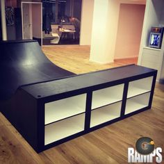 I like the black and the book shelves. SKATE-HOME: Office Lobby