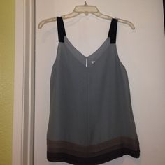 Banana Republic 100% silk 100% poly. lining ONLY WORN ONCE! 100% silk blouse navy blue 2in straps light blue base with 4 different color grays pleated at the bottom. Banana Republic Tops Blouses
