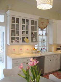Light, airy, white and rose pink kitchen.