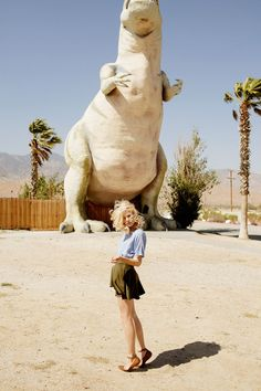 To take a picture by the larger than life concrete dinosaurs - Cabazon,California http://www.cabazondinosaurs.com