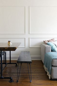 picture frame molding applied - Before & After: Small, Budget-Friendly Changes Transform a Boring Living Room — Sweeten