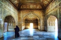 While in north India, a Muslim woman crosses the room...