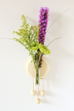 Spruce up your walls with this modern DIY wooden vase.