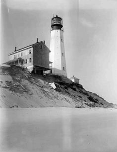 Cape Henlopen Lighthouse and lightkeepers house, pictured from the southeast side, weakened by beach erosion just months before this structure was destroyed by a storm in 1926.  1325 #37.  From the General  Collection at the Delaware Public Archives.  www.archives.delaware.gov