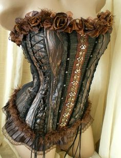 These Steampunk corsets can be dressed up to whatever style you prefer. You can Goth it up, keep it Steampunk or even accessories so it is more Victorian. Heaven knows we love our corsets. Costume Steampunk, Viktorianischer Steampunk, Steampunk Clothing, Steampunk Fashion, Gothic Fashion, Steampunk Necklace, Emo Fashion, Steampunk Lingerie, Steampunk Halloween