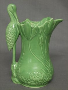 Lot 751 A green glazed Sylvac pottery jug, the handle in the form of a ...