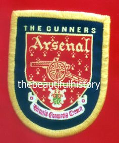 A vintage crest of the Arsenal football club located in London, England.