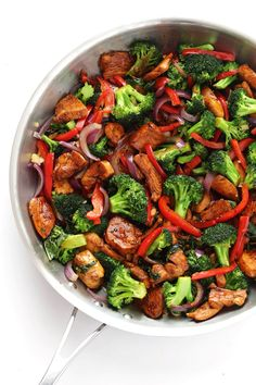 A quick and easy recipe for delicious Thai Basil Chicken, sauteed with lots of fresh veggies and tender chicken and Thai basil!