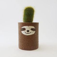 Hey, I found this really awesome Etsy listing at https://www.etsy.com/listing/276052892/sloth-planter-ceramic-succulent-pot