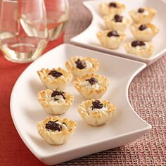 Perfect New Year's Eve app -- Goat Cheese and Olive Mini Tarts.  Love me some cheese and anything salty!!!!  Easy to make especially if you're getting pre-made phyllo dough cups.