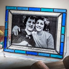 Create a watery scene with sparkling glass. This J. Devlin Glass Art picture frame is designed using seedy clear glass and a variety of cool blue pieces. In sunlight, this refreshing glass picture frame casts watery blue tones in all directions.