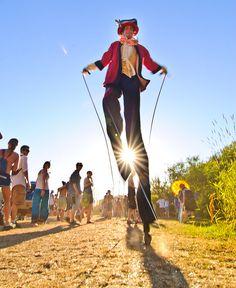 Stilt Walker Jumps Rope, 2010 by Michael Holden, via Flickr