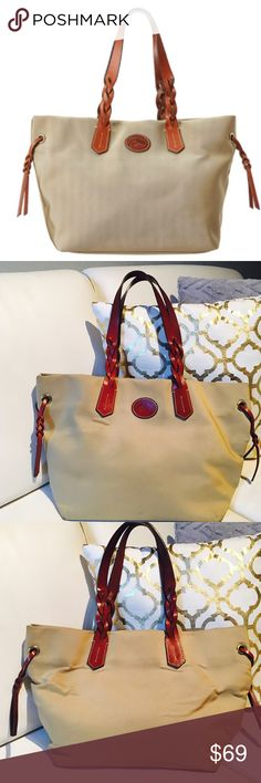 🎀Dooney & Bourke Nylon Shopper🎀 This stunning shopper from Dooney & Bourke™ Durable nylon tote. Snap closure. Leather shoulder straps. Lined interior features a back-wall zip pocket, two slip pockets, and a key hook. Imported. Measurements: Bottom Width: 12 1⁄2 in Depth: 6 3⁄4 in Height: 11 1⁄4 in Strap Length: 22 1⁄2 in Strap Drop: 10 in Weight: 1 lb 7 oz  Some signs of wear in the bottom corner other than that in good condition CHECK PICS Dooney & Bourke Bags Shoulder Bags