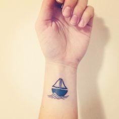 Sailboat wrist tattoo
