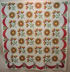 Sunburst and Lily quilt, pre-1860, Poos Collection. This pattern developed as a variation of the Mariner's Compass into the sunburst.  2015 Tokyo International Quilt Festival.  Photo by Julie Fukuda, My Quilt Diary