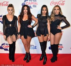 Glamorous appearance: Little Mix looked incredible in coordinating black leotards for Sunday night's Capital FM Jingle Bell Ball at the O2 Arena in London