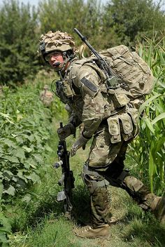 A soldier of the 12th Mechanized Brigade Reconnaissance Force (BRF) cautiously crosses a pathway during a patrol in Afghanistan.