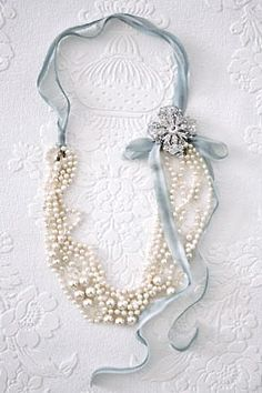 Great idea! ~ Fold beads in half, tie ribbon, add charms and flower to hide fold