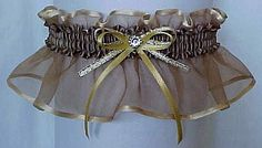 """""""All that glitters, is not gold"""". TARNISHED GOLD BLEND Sheer Elegance Organza Garter with silver accent bow and crystal rhinestone eye by Custom Accessories Garters LLC. Wedding Garter – Bridal Garter – Prom Garter – Fashion Garter. Visit: www.garters.com/page42e.htm"""