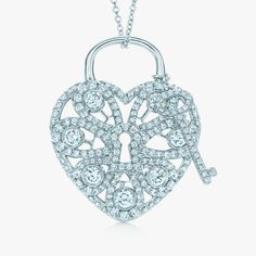 Unlock romance. Tiffany Filigree Heart pendant and key in 18k white gold with diamonds. #TiffanyPinterest