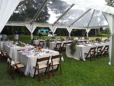 """Mahogany Folding chairs with 48""""x48"""" square tables and 8ft extra wide tables under a clear top tent (straight lines of cafe lights)"""