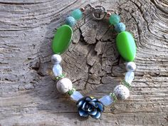 Polymer rosestoneglass beaded bracelet 7 3/4 inch by windinhishare, $6.25