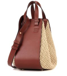 Loewe - Hammock Small raffia and leather tote - Loewe's Hammock Small tote bag comes crafted in Spain from raffia and smooth calf leather in a warm brown hue. Its multi-carry design can be worn as a shoulder bag, held in hand or carried cross body depending on your mood. A hook closure keeps your valuables safe, while zipped details bring tough-luxe edge. Notice the embossed logo – a subtle addition that brings brand recognition. seen @ www.mytheresa.com