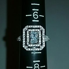 STUNNING 10KT  WHITE GOLD RUSSIAN DIAMOND RING Brand New. Never worn. Amazing 10KT white Gold  Size 7 11/2 kt Russian Simulated Diamond  Clarity clear. Many facet cut Surrounded by delicate Diamonds  Stamped 10KT please see pictures  Wrapped up and shipped with care  No box included Fire and Ice  Jewelry Rings