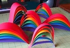 Rainbow craft (table center pieces on a cloud shape..... Multi colored table cloths)