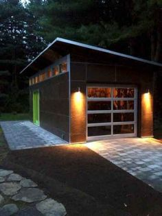 """Want a garage? Using our modular system, we can design the rough opening for a single car garage door for you. Garage openings can be incorporated on the """"short end"""" of either a or Studio Shed. Industrial Garage Door, Wooden Garage Doors, Garage Door Design, Studio Shed, Garage Studio, Backyard Studio, Backyard Sheds, Garden Sheds, Sheds Nz"""